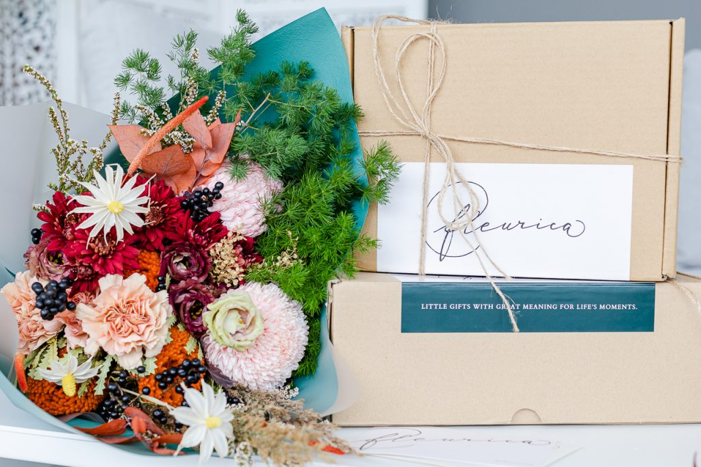 elegant flower bouquet and delivery box in lifestyle picture